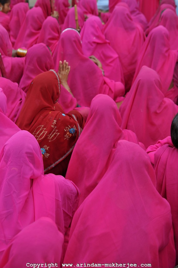 Gulabi Gang or Pink Gang - a group of rural women protesting against gender crimes during one of their group meetings in Bundelkhand, India. Crimes against women have been going on since centuries. In India, women have been categorically marginalized with various types of repressions enforced upon them.