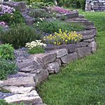 How to create your own flower bed rock walls...I want to do this this summer on the front of our house.