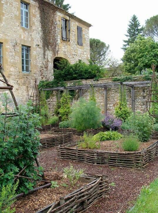Medieval walled garden with woven raised beds