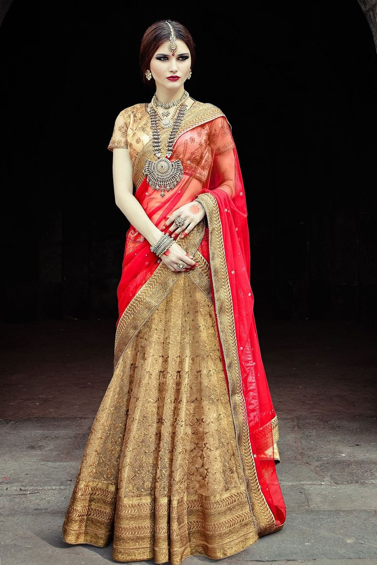 #Gorgeous Golden Zari & Stone worked choli with golden #Embroidered Net Zari & #Stone worked #flared lehenga along with red net stone worked dupatta in Gold Shimmer Border. Color : Red Occasion : #Wedding wear Purity : Blended