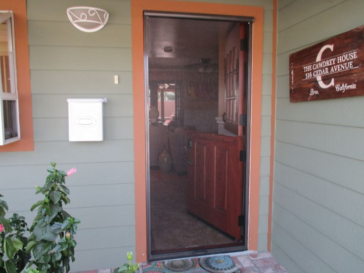 Retractable screens door pulls and dutch door on pinterest for Pull down retractable screen door