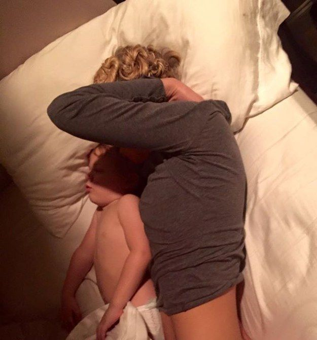 On Nov. 7, as he was getting ready for work, Bobby shared this photo of Rayena taking a nap with Deacon after a long nursing shift. He told BuzzFeed that he thinks his wife looks absolutely beautiful in such candid moments. | A Photo Of A Trauma Nurse Cuddling With Her Son After Work Is Going Viral For All The Right Reasons
