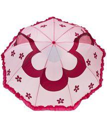 Ombrello rosa con manico fucsia e stampa allover di fiori viola, decorato sul...