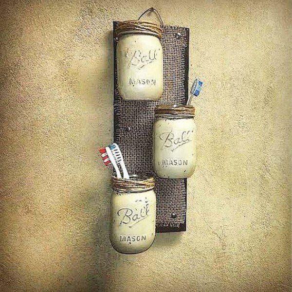 Make these DIY mason jar wall shelves for rustic bathroom decor @istandarddesign