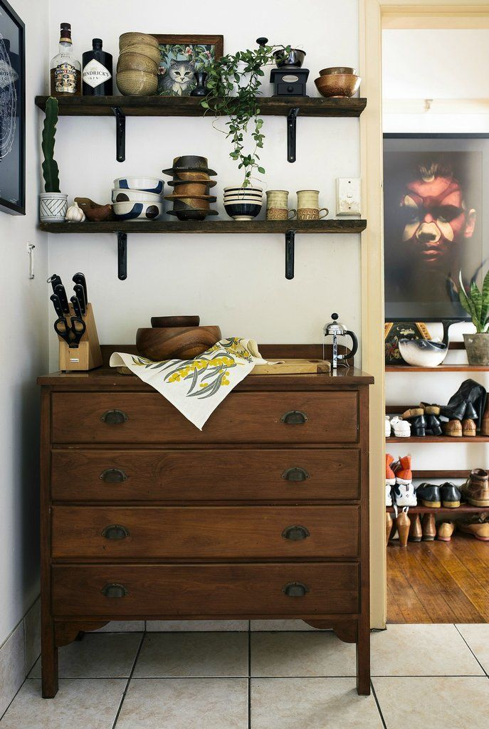 We're impressed by the ingenious way the homeowner used floating shelves and a repurposed dresser to create much-needed kitchen storage.