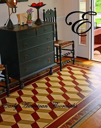 love the colors of this Early American Floorcloth in this foyer...