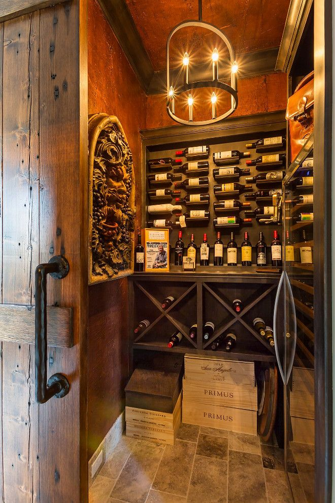 Wine Cellar Walls Are Paneled In Alder Wood With A Dark Stain. The Wine  Cellar Lighting Is Colwyn Chandelier From Currey And Co. Wine Cellar Hendel  Homes