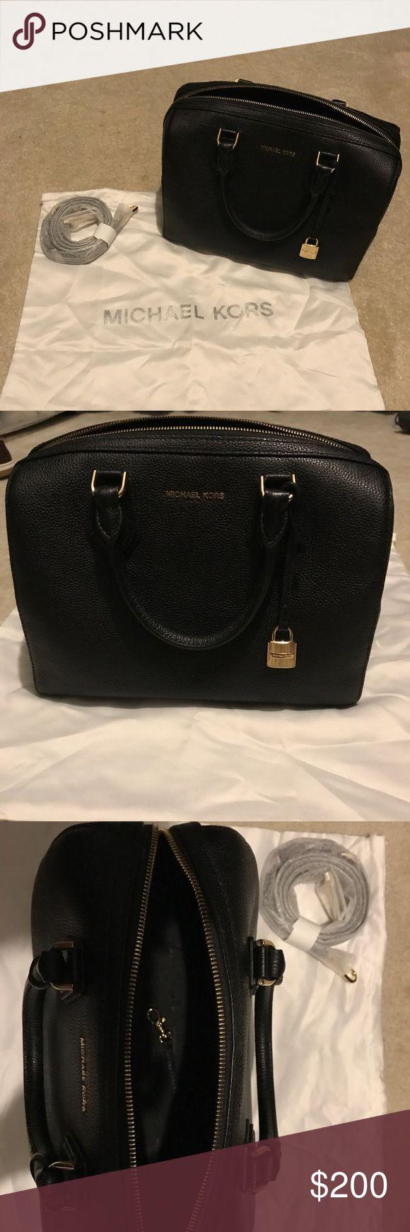 "Michael Kors Purse Michael Kors Mercer Medium Duffel in black leather. Perfect condition! Product Details  11-1/2""W x 8-1/4""H x 6-3/4""D Interior features 1 zip pocket, 4 slip pockets and 1 key finder 4-3/4""L double handles; 20""L-22-1/2""L detachable strap Michael Kors Bags Satchels"
