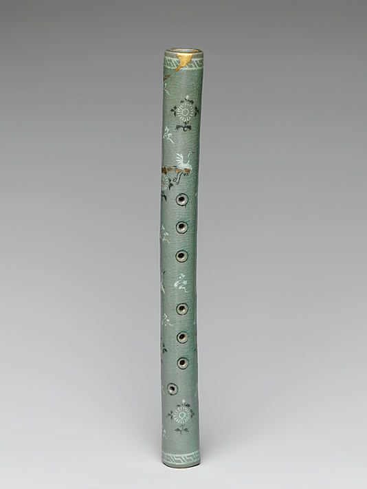 a Korean flute from the Met    Period: Goryeo dynasty (918–1392) Date: early 13th century Culture: Korea Medium: Stoneware with inlaid decoration of cranes, clouds, and chrysanthemums under celadon glaze Dimensions: L. 14 3/8 in. (36.5 cm) Classification: Ceramics Credit Line: Purchase, Friends of Asian Art Gifts, 2008 Accession Number: 2008.71