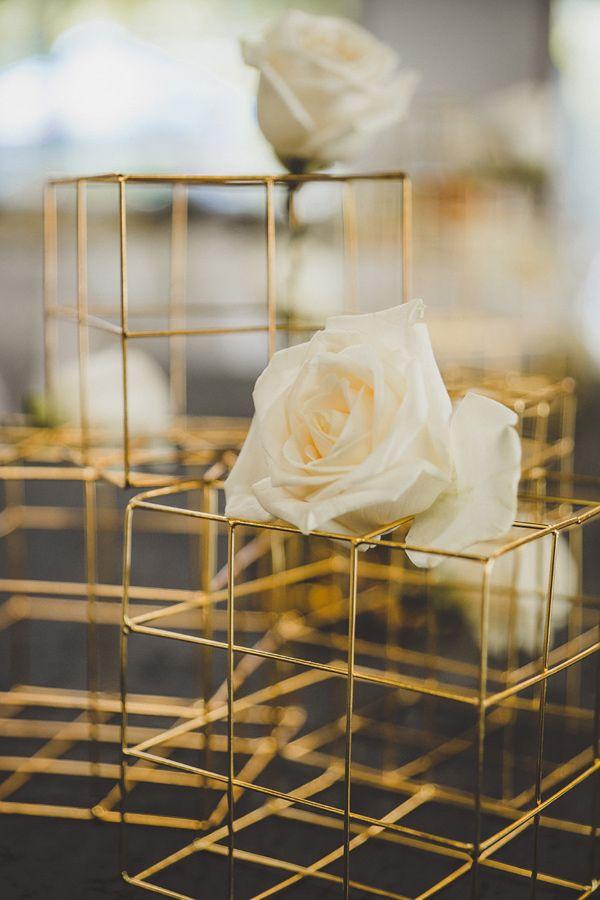 gold geometric centerpiece, photo by Jason Hales Photography http://ruffledblog.com/festive-wedding-inspiration-in-atlanta #weddingideas #centerpieces