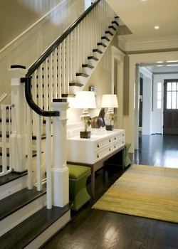 Entryway... Foyer.... I love the dark wood and the cute seating/drawer/alter set up by the stairs