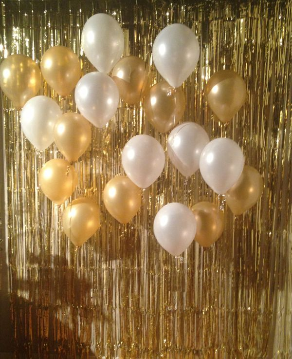 Egyptian Party : Decorations : Gold balloons and shimmery gold backdrop for photobooth area or as food table backdrop