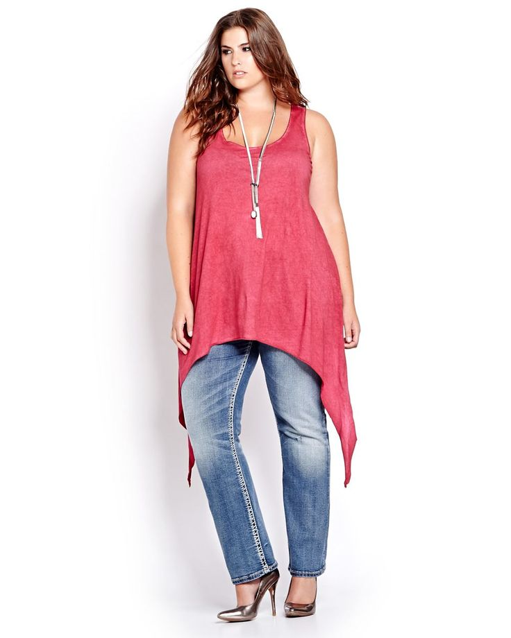 With its worn in wash and trendy sharkbite hem, this sleeveless tank is the perfect mix of authentic chic. Plus size, scoop neck, low armhole, asymmetric hemline. 29 inch center front length.