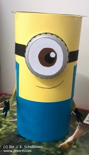 Minion made out of a toilet roll cardboard center, paper and a plastic bottle cap.