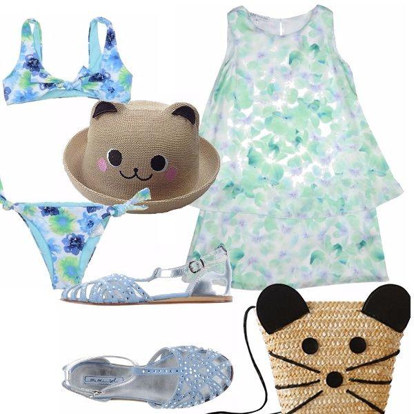 Grazioso outfit dedicato ad una bimba. Bikini in fantasia floreale azzurro, verde e blu. Abitino a balze. Sandaletti azzurri con brillantini. Cappellino e borsina in paglia.