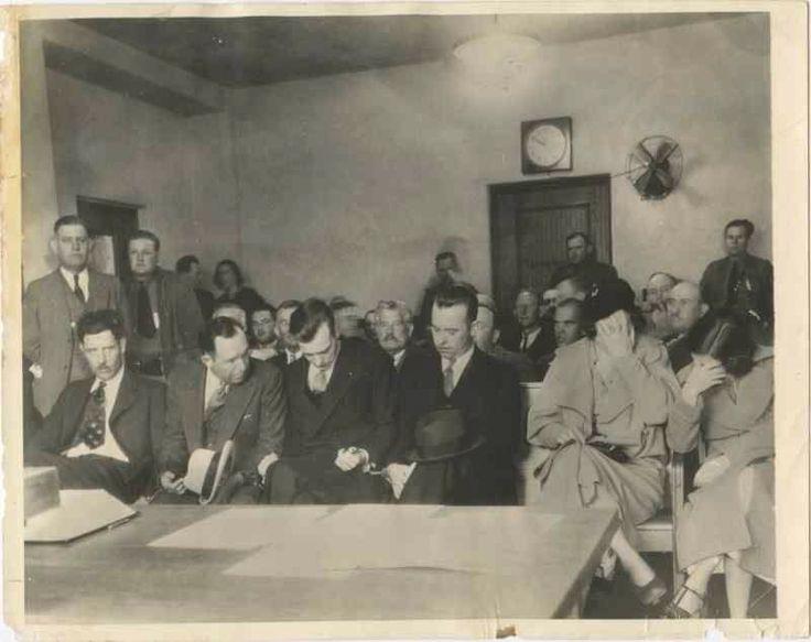 The boys sit next to Billie Frechette, girlfriend of John Dillinger, and Mary Kinder