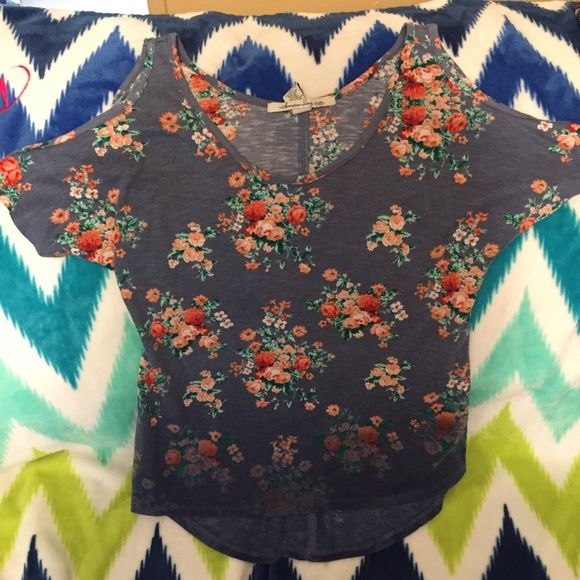 Cold shoulder shirt Floral high low cold shoulder. This shirt is very flattering on. American Rag Tops