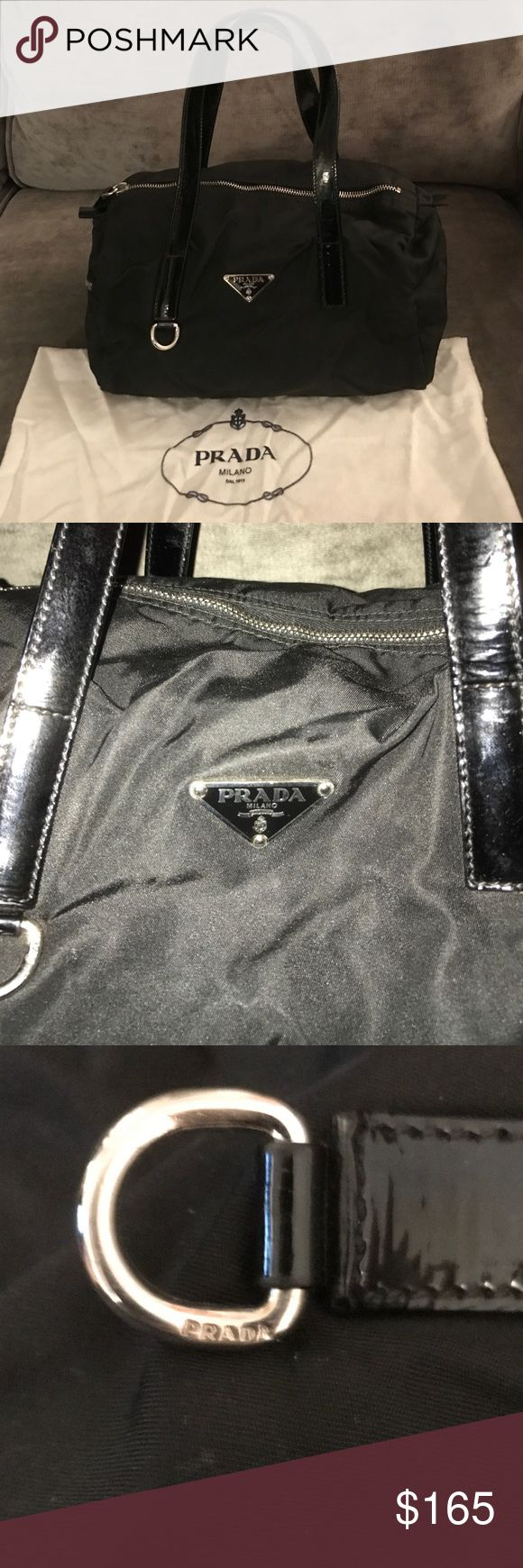 """NEW! Prada Mini Duffle Authentic Prada Mini Duffle BR2394 Semicotrolla Tessuto Nero (black). Bag is nylon and handle straps are patent leather. Bag has a side zip pocket on the outside and measures 7' h x 12.5' l x 7.5' w. Unfortunately the authenticity card has been misplaced, but the """"Prada: Made in Italy"""" tab is visible on the inside of the bag and the metal hoop on the front of the bag has the authentic Prada inscription. Bag comes with original dust bag. Minimal wear and very good…"""