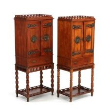 1650/173 - A pair of small walnut cabinets on stands. C. 1900 (?). H. 114 cm. W. 46 cm. D. 29 cm.