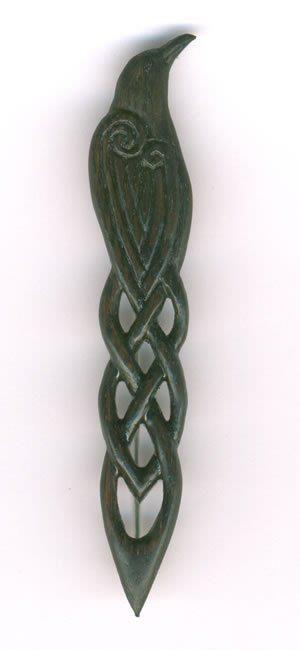 Raven kilt pin in Scottish bog oak over 4000 years old. By Geoff King. Woodland Treasures