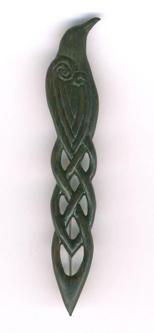 Raven kilt pin in Scottish bog oak over 4000 years old. By Geoff King. Woodland Treasures