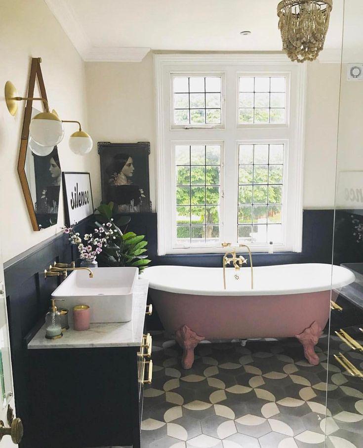 Boho Bathroom With Pink Claw Foot Tub.