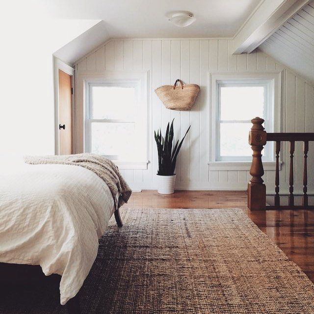 We love the neutral hues and mix of textures in this bedroom.