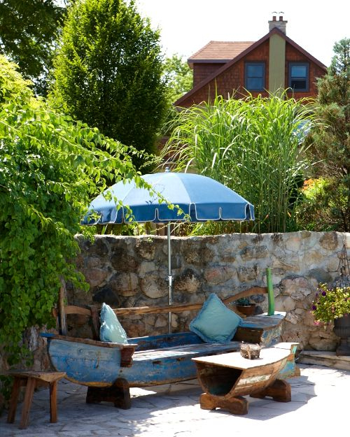 Old canoe turned into a charming bench | patio plans ...