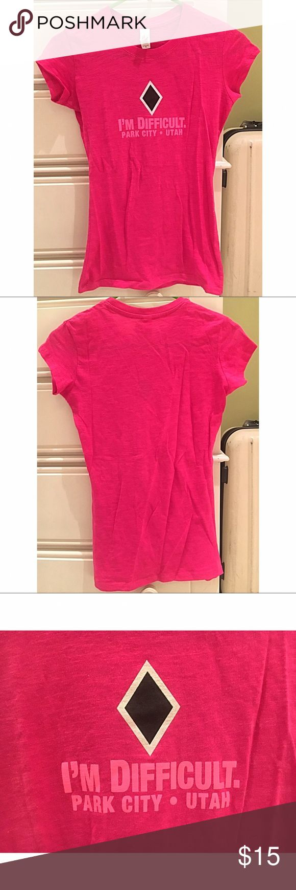 """NWOT Pink Park City T-Shirt This shirt is size Medium and is the perfect souvenir tee. It is New Without Tags and has never been worn. It is in new condition and has no rips or stains. The shirt size is more of a Junior Medium because it fits a smaller than an Adult Medium. It says """"I'm Difficult Park City • Utah"""" and it has a black diamond with a white outline on the front. Pima Apparel Tops Tees - Short Sleeve"""