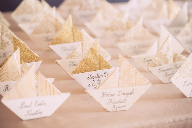 Unique Wedding Escort Place Card Ideas: Let your guests set sail with these pretty origami Sailboat Escort Cards