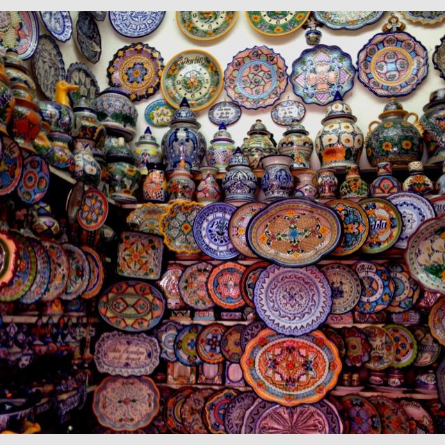 Wall of Talavera ceramics in shop in El Parian, Puebla, Mexico