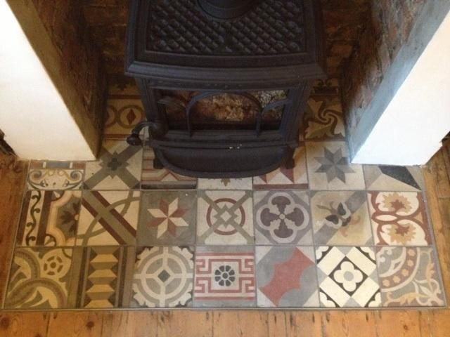 Woodburning stove & reclaimed tiles! http://www.reclaimedtilecompany.com/sites/www.reclaimedtilecompany.com/files/imagecache/product_full/old-tiled-fireplace_0.jpg