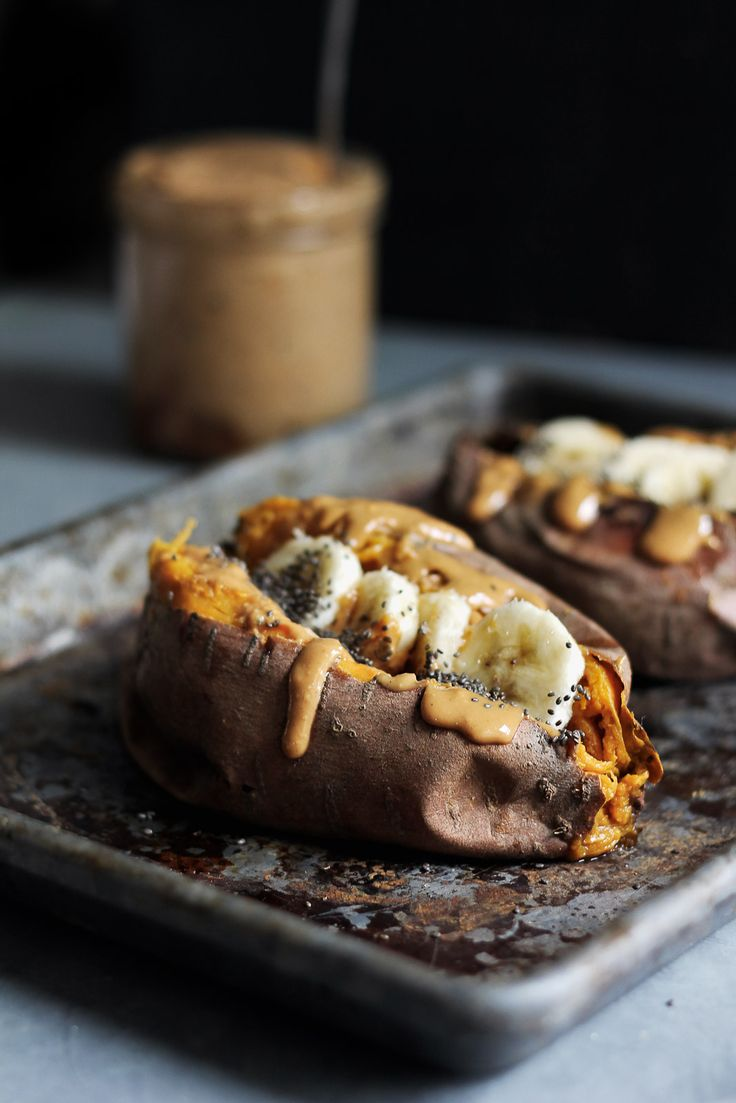 Breakfast baked sweet potatoes stuffed with creamy almond butter, banana slices…
