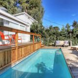 Think of the pool as petite perfection. Take a dip, relax on the deck. The adjacent pool house has a full bath. | HGTV FrontDoor