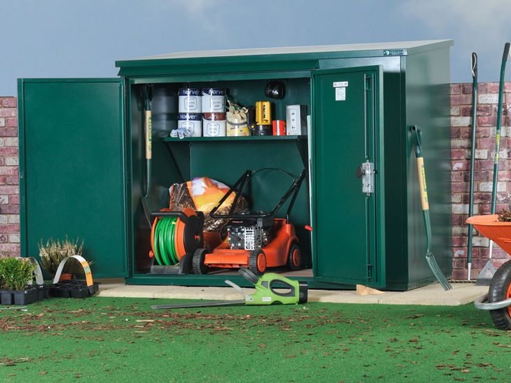 Lawn mower storage ideas lawn mower storage shed lawn for Lawn mower shed