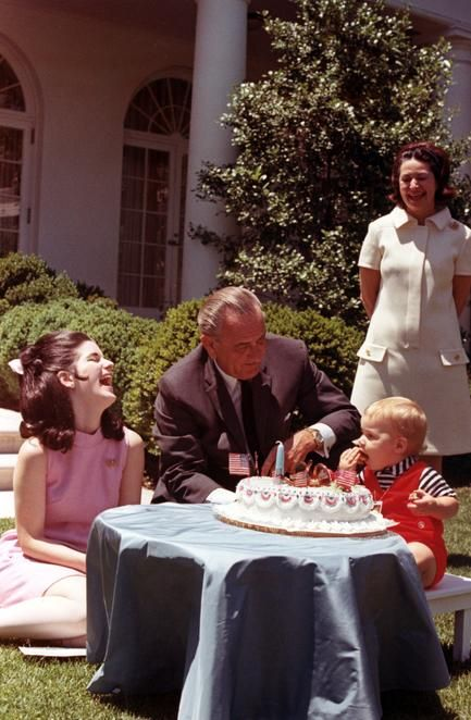 President Lyndon B. Johnson, Lady Bird Johnson, Luci Baines Johnson Nugent and Patrick Lyndon Nugent with birthday cake on the White House lawn. cir. 1968