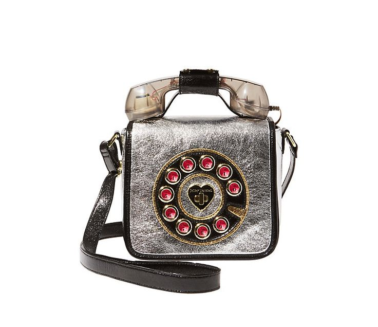 OFF THE HOOK PHONE CROSSBODY | $108 | ★★★★★★★★★★ This phone bag is fun and functional. Its landline handle connects to your own phone to capture some old school charm. Boxy bag. Flap closure. Bold print. Function phone. Top handle. Shoulder strap. Fully lined interior. 8''H x 8.5''W x 4''D. Adjustable straps.