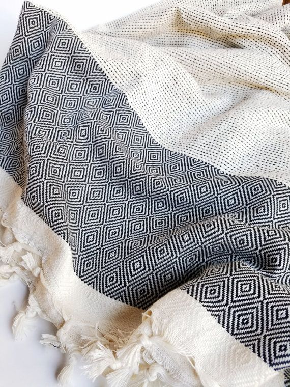 How cool is this? This Boho Turkish Blanket is unlike any weve ever seen, and we are IN LOVE! Its handwoven, enormous, made from premium, super soft Turkish cotton, and may just be what you have been looking for all your life! This Boho Blanket is lightweight, but still heavy duty... and does it all. Use it as a bed cover, a beach blanket, picnic blanket, or stylish addition to that concert on the green youve been dreaming about. You can even use it as a tablecloth for your next dinner party…