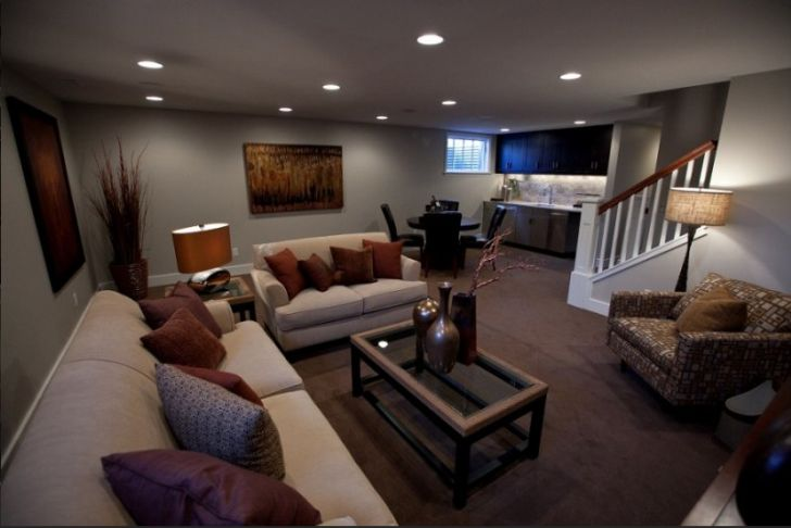 Ways You Can Apply Small Basement Ideas Rather Comfortably: Romantic Lighting Living Space In Exquisite Small Basement Remodeling Ideas With Comfy Grey Sofa Sets And Red Brown Grey Cushions Also Ornaments On Coffee Table Along With Pictures Painting ~ wiligear.com Interior Design Inspiration