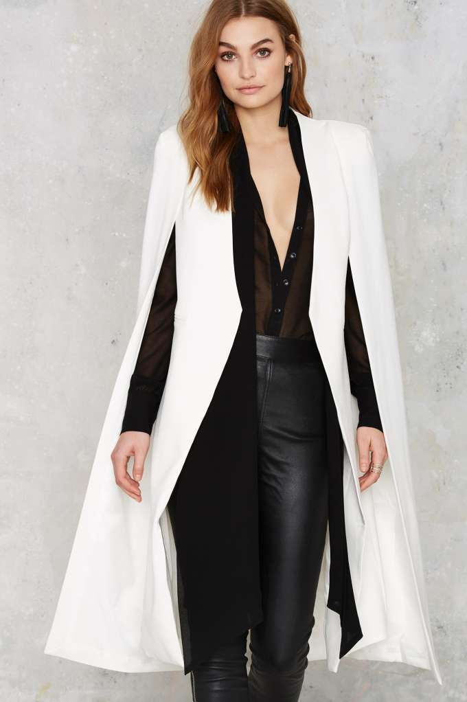 The On the Fly Cape Jacket is a structured white beauty with a cape overlay, faux pockets at waist, light padding at shoulders, and full lining