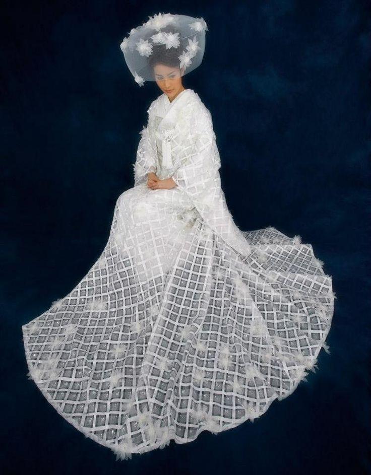 An ultra-modern shiromuku ( a primarily white uchikake, or wedding kimono.)