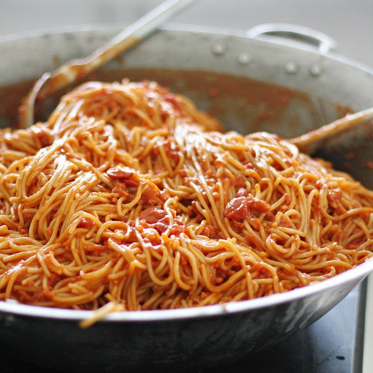 Filipino Spaghetti Recipe Main Dishes with noodles, tomato sauce, tomato paste, minced onion, minced garlic, oil, ground pork, carrots, hot dogs, water, salt, seasoning mix, evaporated milk, grating cheese