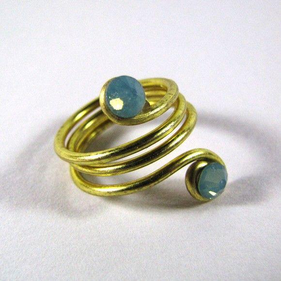 Fingertip made of brass wire with pacific blue zwarovski stones.