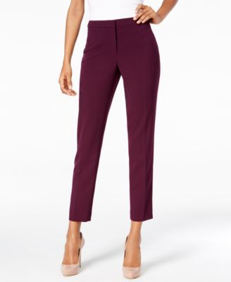 Take your professional look to the next level in these petite, highline pants from Calvin Klein that pair perfectly with your favorite blouses and blazers. | Polyester/Rayon/Spandex | Dry clean | Impo