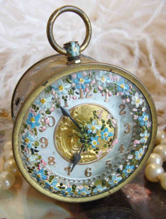 Circa 1880s Exquisite Paris Apartment Clock Which Has A Gilt Face and Is Adorned With A Sprinkling Of Dainty Hand Painted Pink and Blue Forget Me Nots