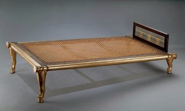 Queen Hetepheres inclined bed from the Ancient Egyptian Old Kingdom. Bed shown with woven seat, unidirectional lion paw feet, and footrest.