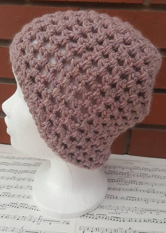 This is a hand crocheted hat made in a luxurious wool and alpaca mix yarn. This hat is suitable for an adult,and is incredibly soft. This hat is a little large on me so would be perfect for those with larger heads or lots of hair. A perfect gift for anyone in your life, or why not treat yourself! The simple open crochet patterned design means this beanie is perfect for cooler autumn nights and suitable for a woman or man. Made from a pink chunky yarn and hand washable. This is a ready…