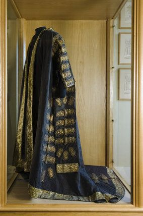 The black silk damask robe used by Disraeli as Chancellor of the Exchequer in the Bartolozzi Room at Hughenden Manor, Buckinghamshire, home of prime minister Benjamin Disraeli between 1848 and 1881. Apparently previously belonged to Pitt the Younger.
