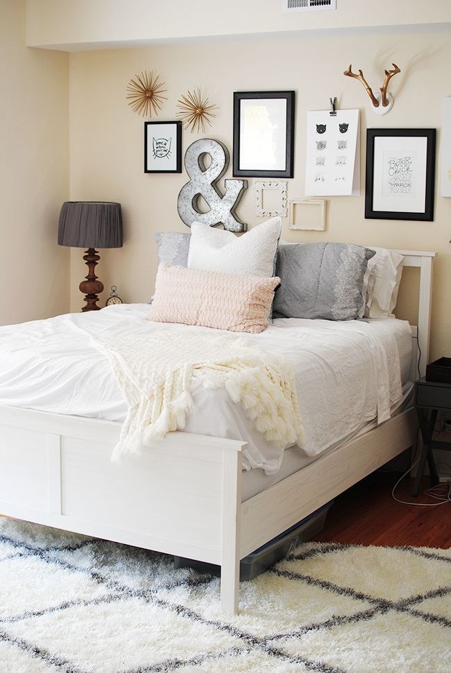 Master Bedroom with cheeky gallery wall art above the bed