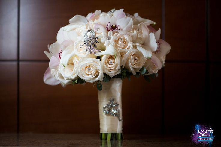 Ivory rose, white cymbidium orchids and stephanotis bridal bouquet embellished with crystal